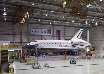 The space shuttle Endeavour is seen atop the Over Land Transporter (OLT) in a hangar at Los Angeles International Airport, in this September