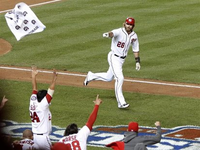 Washington Nationals' Jayson Werth points to the bench after hitting a game winning walk off solo home run during the ninth inning in Game 4