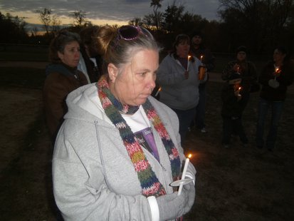 Claudia Blake is Stephanie Low's mother, participating in a candlelight vigil at Wausau's Oak Island park 10/10/12