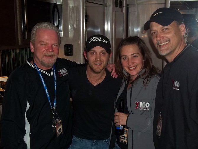 Y100 surrounds Justin Moore and steals his beer... Dan Stone told us it was okay... sorry HR.