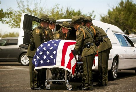 Law enforcement colleagues of U.S. Border Patrol agent Nicholas Ivie, 30, prepare to lift his casket into a hearse during his funeral in Sie