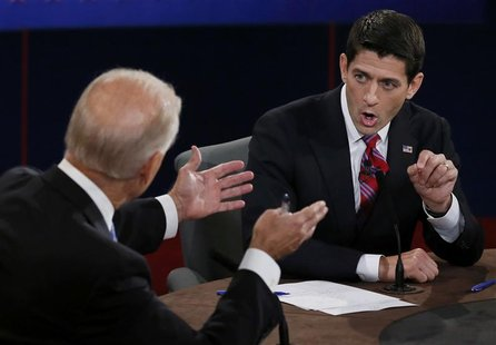 Vice President Joe Biden (L) and Republican vice presidential nominee Paul Ryan discuss a point during the vice presidential debate in Danvi