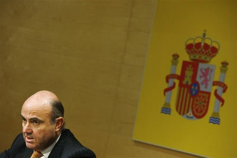 Spanish Economy Minister Luis de Guindos attends a news conference with European Economic and Monetary Affairs Commissioner Olli Rehn (not p
