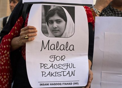 An activist from non-governmental organisation Insani Haqooq Ittihad hold a picture of Malala Yousufzai during a demonstration in Islamabad