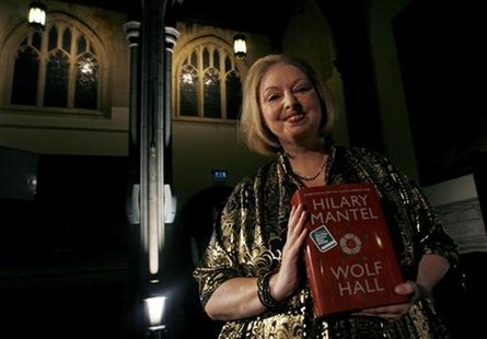 "Author Hilary Mantel poses with her book ""Wolf Hall"" after winning the 2009 Man Booker Prize for Fiction at the Guildhall in London October"