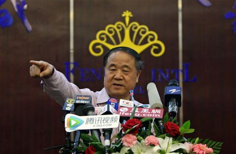 Chinese writer Mo Yan gestures during a news conference in his hometown of Gaomi, Shandong province October 12, 2012. Chinese Nobel Literatu