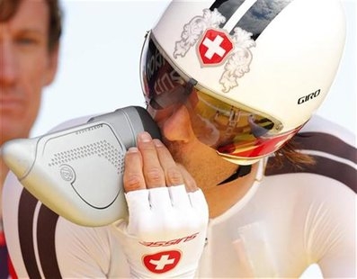 Switzerland's Fabian Cancellara takes a drink befor starting in the men's cycling individual time trial at the London 2012 Olympic Games Aug
