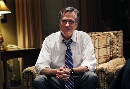 Republican presidential nominee Mitt Romney watches the Vice Presidential debate in his hotel room in Asheville, North Carolina October 11,