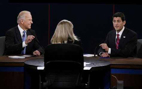 U.S. Vice President Joe Biden (L) and Republican vice presidential nominee Paul Ryan (R) debate in front of moderator Martha Raddatz (C) dur