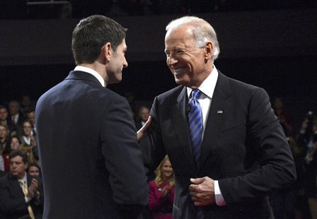 U.S. Vice President Joe Biden (R) and Republican vice presidential nominee Paul Ryan shake hands at the conclusion of the vice presidential