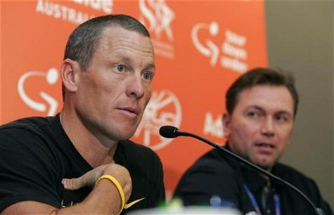 Seven-time Tour de France winner Lance Armstrong (L) talks to the media as Astana team general manager Johan Bruyneel looks on during news c