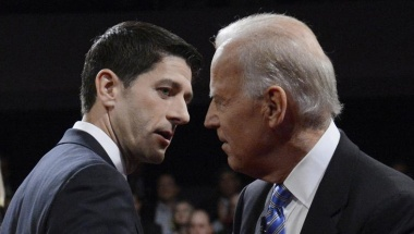 Republican vice-presidential nominee Paul Ryan and Vice President Joe Biden (D) chat at the conclusion of the vice presidential debate in Danville, Kentucky, October 11, 2012. REUTERS/Michael Reynolds/POOL
