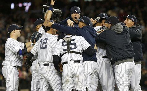 The New York Yankees celebrate after defeating the Baltimore Orioles in Game 5 of their MLB ALDS baseball playoff series in New York, Octobe