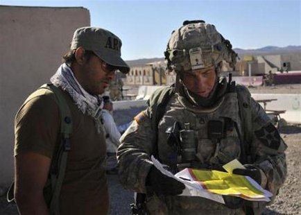 Staff Sgt. Robert Bales, (R) 1st platoon sergeant, Blackhorse Company, 2nd Battalion, 3rd Infantry Regiment, 3rd Stryker Brigade Combat Team