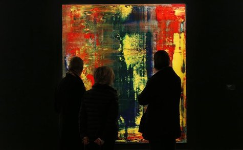 "Visitors look at Gerhard Richter's ""Abstraktes Bild (809-4) from 1994 which has an estimated value of £9 to £12 million (US$14.1-$18.8 milli"