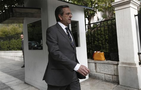 Greek Prime Minister Antonis Samaras walks towards his office in Athens shortly after arriving in Greece October 5, 2012. REUTERS/Yorgos Kar