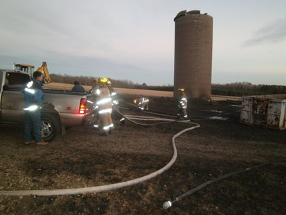 Firefighters cleaning up after a barn burned 10/12/12 northeast of Wausau on Paradise Lane.