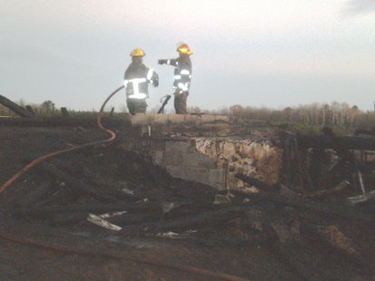 The foundation is all that's left of a barn that burned 10/12/12 on Paradise Lane northeast of Wausau