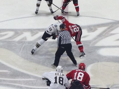 Western Michigan center Josh Pitt takes the face off against St. Lawrence University Friday 10/12/2012 at Lawson Arena