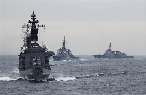 Japanese Maritime Self-Defense Force (MSDF) destroyer Kurama (L), which is carrying Japan's Prime Minister Yoshihiko Noda, leads the MSDF fl