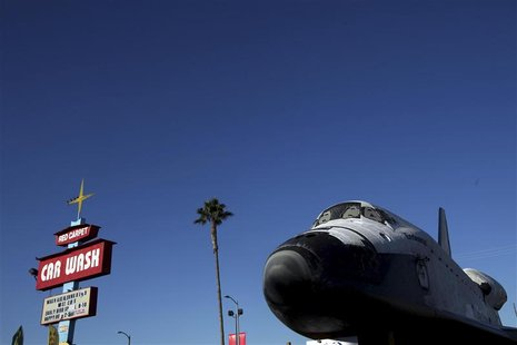 Space Shuttle Endeavour moves down Martin Luther King Blvd. on the last leg of its journey to the California Science Center at Exposition Pa