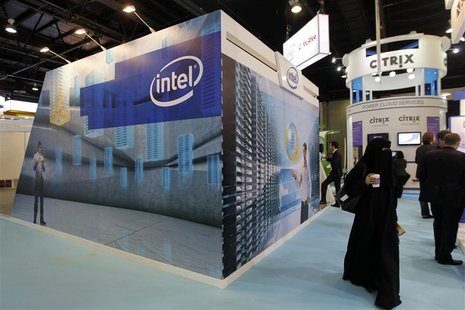 People walk past the Intel stand on the first day of the Gulf Information and Technology Exhibition (GITEX) at the Dubai World Trade Centre