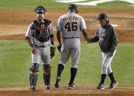 Detroit Tigers manager Jim Leyland pulls relief pitcher Jose Valverde from the game as Tigers catcher Gerald Laird looks on during the ninth