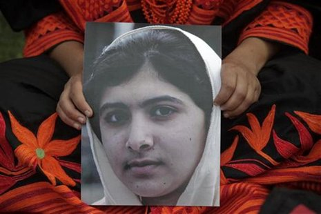 A student holds an image of Malala Yousufzai, who was shot on Tuesday by the Taliban, during a rally in Lahore October 14, 2012. REUTERS/Moh