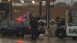 Authorities on the scene of a fatal traffic stop at the Citgo gas station on Ridge Road in Ashwaubenon on September 13, 2012. (courtesy of FOX 11).