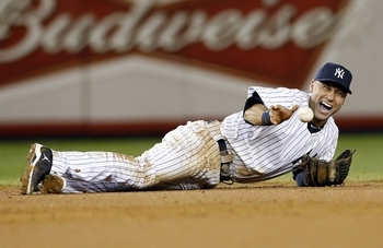 New York Yankees shortstop Derek Jeter screams as he injures himself fielding a ball hit by Detroit Tigers' Jhonny Peralta during the 12th inning of Game 1 of their MLB ALCS playoff baseball series in New York, October 13. (REUTERS/Mike Segar)