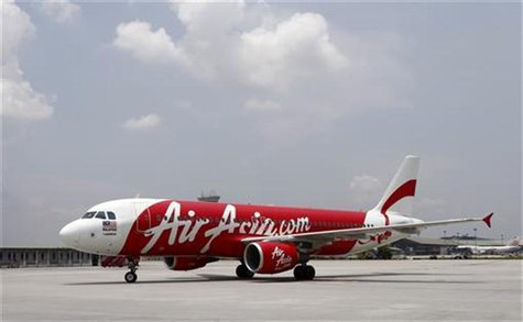 An Air Asia Airbus A320-200 aircraft approaches its parking space at the Low Cost Carrier Terminal (LCCT) in Sepang, outside Kuala Lumpur Ma