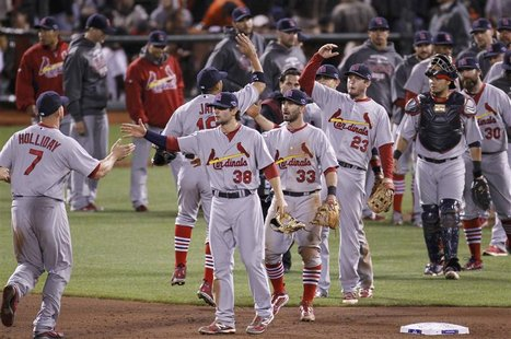 The St. Louis Cardinals celebrate after defeating the San Francisco Giants in Game 1 of their MLB NLCS playoff baseball series in San Franci