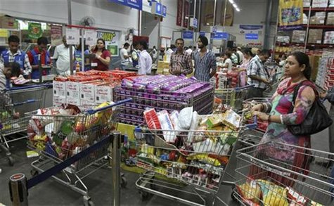 Customers wait to pay for their goods at a Best Price Modern Wholesale store, a joint venture of Wal-Mart Stores Inc and Bharti Enterprises,
