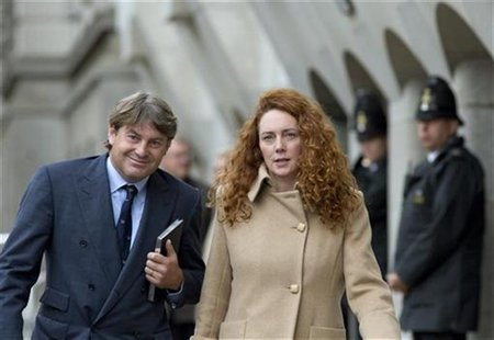 Former News International chief executive Rebekah Brooks and her husband Charlie leave the Old Bailey court in London September 26, 2012. RE