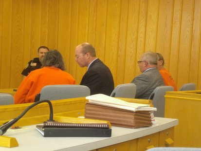 Dolores and Ronald Disher in Portage County Court along with their defense attorneys.