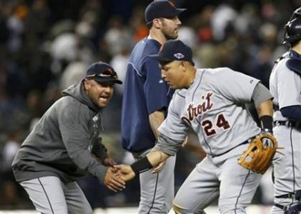 PUT 'ER THERE! Detroit Tigers catcher Gerald Laird (L) celebrates with third baseman Miguel Cabrera as pitcher Justin Verlander (C) walks past them after the Tigers defeated the New York Yankees in Game 2 of their American League Championship Series at Yankee Stadium on Oct. 14, 2012. REUTERS/Mike Segar