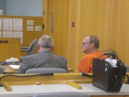 Ronald Disher in court alongside his attorney.