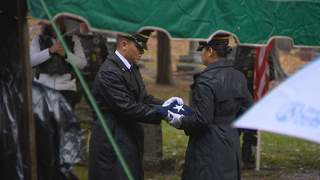 An honor guard folds the flag in honor of Lt. James A. Des Jardins. Des Jardins was buried on Sunday, October 14, 2012. His plane was shot down over Germany in 1944. (courtesy of FOX 11).