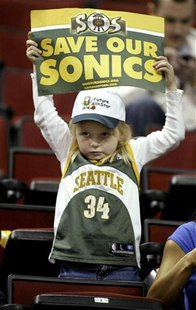 "Seattle Supersonics fan Kayla Rydberg, 5, of Auburn, Washington, holds up a ""SOS: Save our Sonics"" sign before the start of their NBA game a"