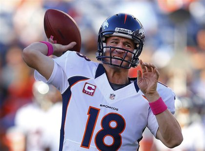 Denver Broncos quarterback Peyton Manning warms up prior to during their Monday NFL football game against the San Diego Chargers in San Dieg