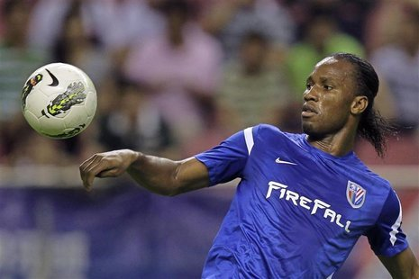 Shanghai Shenhua's striker Didier Drogba controls the ball during the Chinese Super League match against Hangzhou green town at the Shanghai