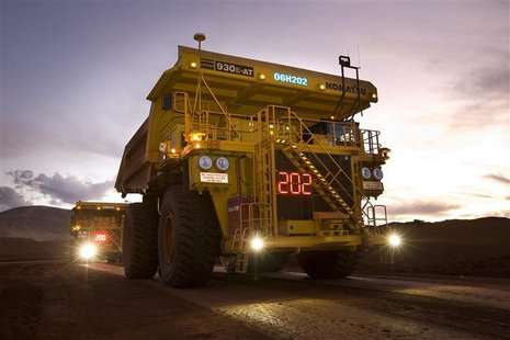 Remotely controlled tipper trucks operate at a Rio Tinto iron ore mine in Western Australia in this undated handout picture made available M