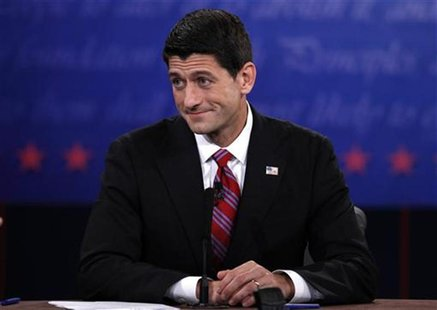 U.S. Republican vice presidential nominee Paul Ryan listens to U.S. Vice President Joe Biden during the U.S. vice-presidential debate in Dan