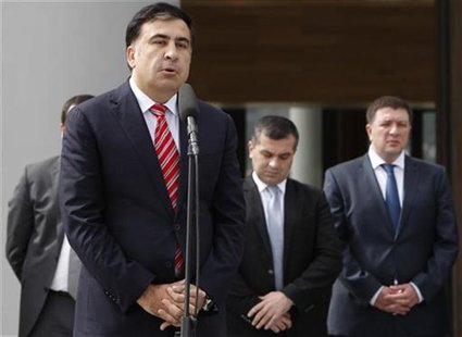 Georgia's President Mikheil Saakashvili speaks to the media after his meeting with Bidzina Ivanishvili, prime minister nominee and Georgian