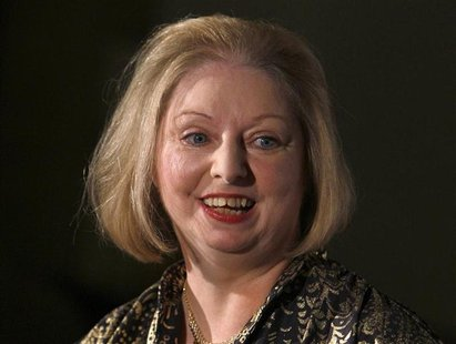 "Author Hilary Mantel laughs during a photocall after winning the 2009 Man Booker Prize for Fiction with her book ""Wolf Hall"" the the Guildha"