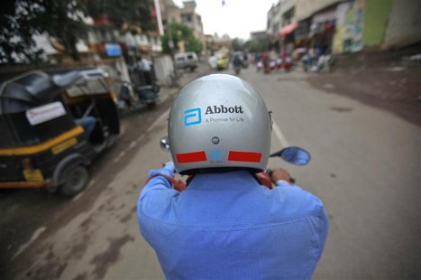 A representative for Abbott rides his bike to a doctor's clinic in Pune August 27, 2012. Picture taken August 27, 2012. REUTERS/Danish Siddi