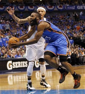 Oklahoma City Thunder guard James Harden (R) drives on Dallas Mavericks guard Delonte West during the second half of their NBA Western Confe