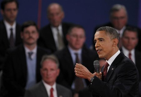U.S. President Barack Obama (R) speaks as he debates Republican presidential nominee Mitt Romney during the second U.S. presidential debate