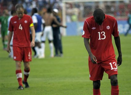 Canada's Kevin McKenna (L) and Atiba Hutchinson react after their team's loss against Honduras during their 2014 World Cup qualifying soccer
