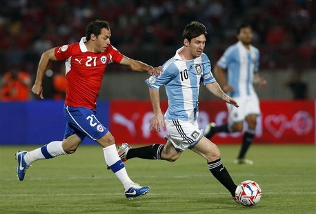 Argentina's Lionel Messi fights for the ball with Chile's Marcelo Diaz during their 2014 World Cup qualifying soccer match in Santiago Octob
